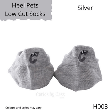 Silver colour ankle socks with C shaped monster embroidered on the back of the heel.