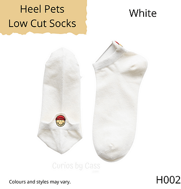 White colour ankle socks with happy face monster embroidered on the back of the heel.