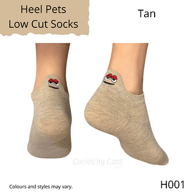 Tan colour ankle socks with comical monster face embroidered on the back of the heel.