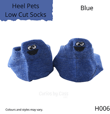 Blue colour ankle socks with comical monster face embroidered on the back of the heel.