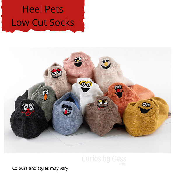 A display of different coloured ankle socks with comical monster face embroidered on the back of the heel.