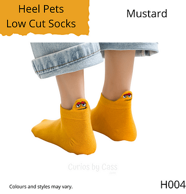 Mustard colour ankle socks with comical monster face embroidered on the back of the heel.