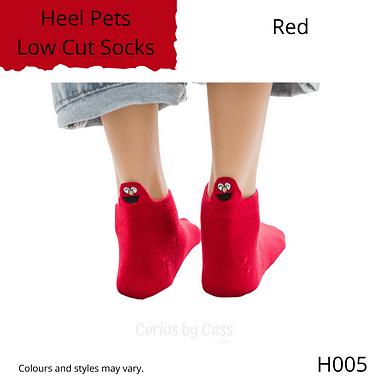 Red colour ankle socks with comical monster face embroidered on the back of the heel.