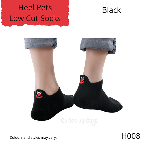 Black colour ankle socks with comical monster face embroidered on the back of the heel.