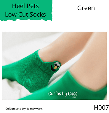 Green colour ankle socks with comical monster face embroidered on the back of the heel.
